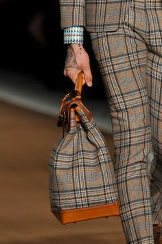 Love the bag, a lot!!  Love the cloth, a lot!! But the syle of the suit?? Not!!