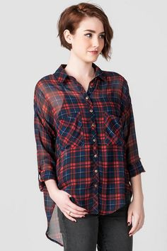 """Easy-going is the Stratford Plaid Blouse. A dark red & navy plaid covers this lightweight chiffon blousewith a button down front & slit up the back. Keep it casual by styling with a pair of jeans & ankle boots.<br /> <br /> - 26"""" length from shoulder to hem<br /> - 48"""" chest<br /> - 48"""" waist<br /> - measured from a size small<br /> <br /> - 100% Polyester<br /> - Machine Wash<br /> - Imported"""