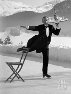 Waiter Rene Brequet with Tray of Cocktails as He Skates Around Serving Patrons at the Grand Hotel Photographic Print by Alfred Eisenstaedt a...