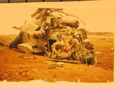 """What's left of a CH-53 at the Siege of Khe Sanh. 22February68. We called the CH-53 the """"Jolly Green Giant."""" Photo courtesy of the National Archives. BRAVO! COMMON MEN, UNCOMMON VALOR @ https://bravotheproject.com/. #BRAVO! #USMC #KheSanh #VietnamWar #CH53 #NARA"""