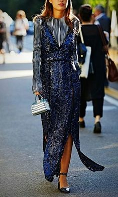 Maxi Dresses can be high fashion, and an make the perfect street-style look. Here are all the best maxi dresses for every body and fashion style. We love this sequin maxi paired with a simple blouse underneath..