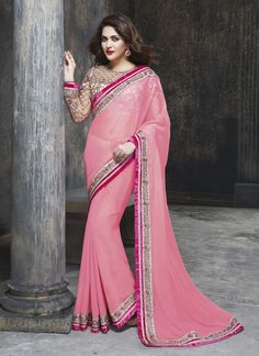 You will be the center of attention in this attire. Be the sunshine of everybody's eyes dressed in such a desirable pink faux chiffon designer saree. The ethnic embroidered and patch border work wit...