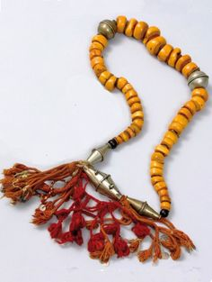 Morocco ~ south east side of the Atlas region | Necklace (Ilouban); amber separated with leather discs, silver and wool | 1'100€ ~ sold (June '10)