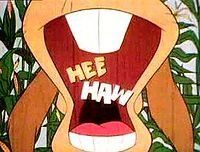 Hee Haw...OMG! My grandfather would watch this every Saturday and crack up at the dancing pigs every time...I still remember the words to the 'Gloom, Despair' song!