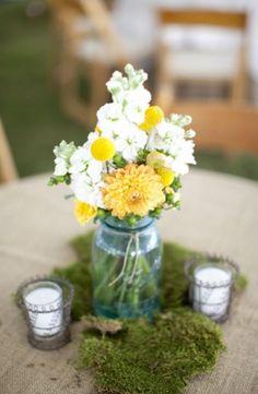 Mason jar arrangement with zinnias, billy balls and stock