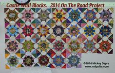 Castle Wall Blocks.  My 2014 On The Road Project.    Hand piecing using Inklingo (see my blog/website for link to collection and search blog for tuturial).     26  BLOCKS!  I just tossed them up on the design wall...and I am thinking they just might be set now without sashing.   I already designed a setting with sashing but I am loving this riot of color and pattern.   This is now a workshop....and by the looks of booking it is going to give Pieced Hexies Buffett a run for 1st place next…