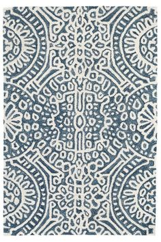 The Temple Ink Micro-Hooked Wool Rug inspires quiet contemplation with its radiating medallion pattern, adding a calming focal point.