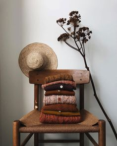 stack of autumnal toddler sweaters on chair. / sfgirlbybay