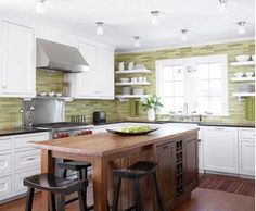 Muted greens and warm wood colours create a fresh atmosphere in the kitchen.