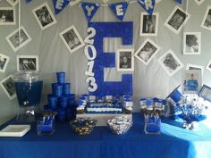 Good idea to draw decorating ideas. Using the blue and white school theme colors. Make a large SC for the background building around with Bulldog and photos of the graduating seniors.