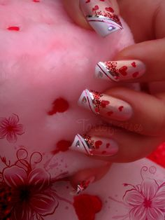 Image from http://publicwallpapers.org/wp-content/uploads/2015/01/valentines-day-nail-art-2.jpg.