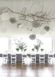 Charm your guests at your dinner party, charity gala or wedding with a tasteful grey and white tissue paper pom arrangement.