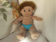 "Cuddly 12"" Rag Doll (Unclothed) - Mixed. Beautiful Mixed Race Boy. A full head of fuzzy hair!   Look at those sweet brown eyes, I think he wants you to adopt him! His thick golden brown hair will have you re-styling it daily! He has very light brown skin and comes with his own pair of sky blue pants."