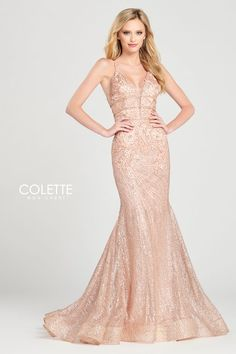 Colette for Mon Cheri CL12013. Sleeveless cracked ice fit and flare with a plunging v-neck, natural waist with stone accent band detail, criss cross lace up back, lace appliques scattered throughout the dress, horsehair hem and a sweep train.