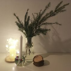 Simple Christmas decoration with natural elements, lights and candles.