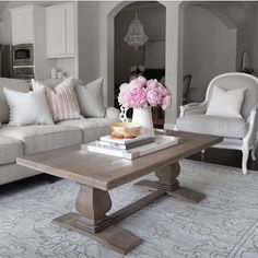Pink peonies living room inspo Benjamin Moore classic gray  French flair, restoration hardware Lyon chair, coffee table styling books, white chandelier, gray paint