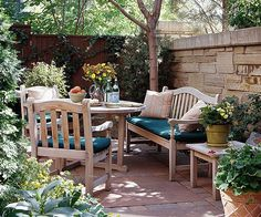 Keep comfort in mind when you choose furniture for your small backyard. No matter how lovely your landscape, no one wants to spend time teetering on an uncomfortable metal chair. Look for pieces with deep seating and wide arms that invite guests to sit and chat a while. Here, teak furniture with thick cushions and pillows encourages long talks.