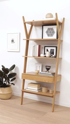 How To Style an Open Shelf: add personal touches, introduce depth with photos, and layer in books for a complete look.