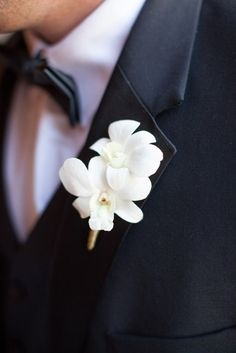 The boutonnieres will be white dendrobium orchids wrapped in gray ribbon with the stems showing. Boutonnieres, Orchid Boutonniere, Groomsmen Boutonniere, Groom And Groomsmen, White Orchid Bouquet, White Wedding Bouquets, Floral Wedding, Orchid Bouquet Wedding, Prom Flowers