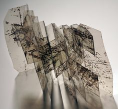 """This one is made of mica already scribed on. It allowed Kyle to explore a book as a transparent screen.  """"I often envision the flag book as a movable screen to define space. Light and shadow capture my interest. At Penland I came across pieces of mica with inherent markings. They were transformed into this flag book."""