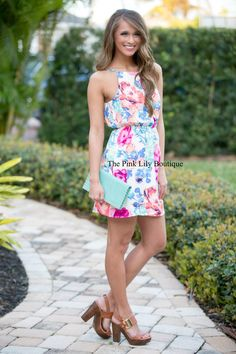 You will be enthralled by this floral dress! We love the bright, spring colors and the overlapping fabric in the back! It also features spaghetti straps, an elastic band around the waist, and lining underneath! Add wedges and you're set!