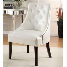 Coaster Upholstered White Accent Chair in Cappucino Finish - Create a sophisticated traditional style in your living room or family room with this elegant chair. The button tufted back, nail head trim, and dark finished legs create the a most elegant allure. Covered in a faux leather with a luxurious quilted look, this lounge chair is sure to complement your home decor.