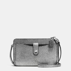 This hands-free, tailored design with detachable strap converts from shoulder bag to crossbody to clutch. Finished by hand in refined pebble leather, it has a fun pop of color inside in the form of a pull-out pouch that can be carried separately.