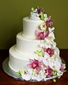 "I like the flowers flowing up the side of the cake and the ""beading"" of frosting in the crevases"