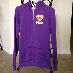 Victoria's Secret Pink LSU Hoodie Victoria's Secret Pink LSU zip up hoodie. The back has Mike the tiger with sequins and silver studs around him!!! This is really cute, I just don't wear it living in south Florida!!! The string is missing , other than that it's in good condition!!!! PINK Victoria's Secret Tops Sweatshirts & Hoodies