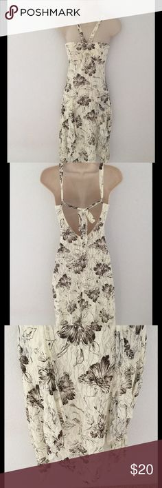 Beautiful cream and brown halter dress, size small Beautiful cream-colored halter dress with brown flowers by JNJ Fashion, Hawaii.  It has an asymmetrical, shark-bite, hemline with the halter tie being tied mid back.  This dress is a size small, 90% polyester and 10% spandex.  It has only been worn once and is in excellent condition. JNJ Fashion, Hawaii Dresses Midi