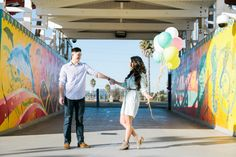 santa cruz engagement photographer, santa cruz beach boardwalk engagement session, carnival engagement session, beach engagement photos, under the pier engagement photos, balloons, playful engagement photos, whimsical engagement photography, coastal engagement, bay area wedding photography, jasmine lee photography