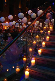 Festoon lights, paper lanterns, willow archways with pealights and storm lanterns lining the stairs by www.stressfreehire.com #venuetransformers
