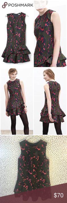 NWT Banana Republic Drop Waist Ruffle Camo Dress So cute and perfect for any season! Brand new with tags! Size 10. Drop waist ruffle accent. Sleeveless. Jacquard Camo. Zip detail. Blogger favorite. No trades!! 072917100tmr Banana Republic Dresses Mini