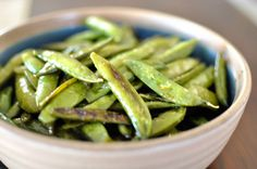 Roasted sugar snap peas. Gently toss in olive oil. Sprinkle with sea salt and cracked pepper. Add minced garlic or garlic powder. Place in single layer on a cookie sheet lined with foil. Roast at 450F for 10-15 minutes, or until crisp but lightly browned.