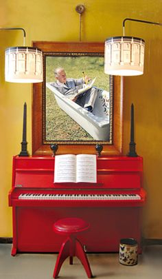 Okay, so I found this looking for pianos, but fell in love with the picture of the man writing in a bathtub above it.