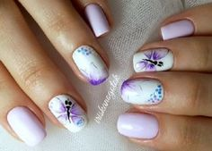 White, blue and purple themed butterfly nail art design. Simple beautiful and pleasant to the eyes. The aesthetics of the design is wonderful and you can just look at the butterfly wings and the bashful background designs and never get tired of them.