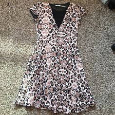 Leopard print dress Leopard dress with black sheer covering cleavage area Francesca's Collections Dresses