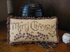 Merry Christmas by La-D-Da Design.  From  JCS Christmas Ornament issue.  Want to stitch with different color combos