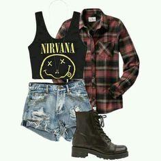 Nirvana crop top, plad shirt, high wasted shorts, and boots.