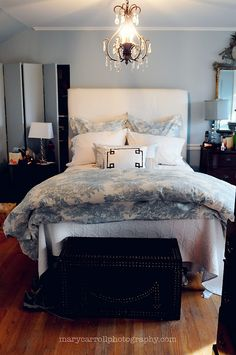 toile bedding, powder blue paint, black leather trunk