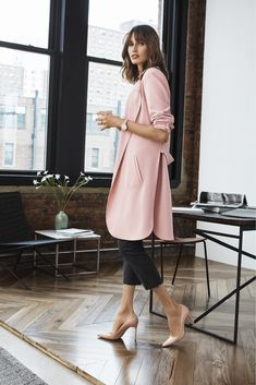 A softly tailored silhouette infuses our long jacket with feminine flair; the open-front design adds a sense of ease. Get the look exclusively at New York and Company.