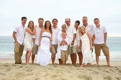 Casual Family Portrait of an extended family wearing khaki and white, taken in Laguna Beach, California. ©Photo by Val Westover Photography - Orange County California & Salt Lake City Utah. All Rights Reserved.