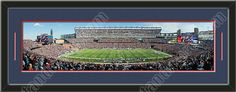 One framed large New England Patriots stadium panoramic, double matted in team colors to 39 x 13.5 inches.  The lines show the bottom mat color.  $129.99 @ ArtandMore.com