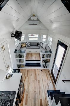 Tiny house on a gooseneck trailer with a lounge area over the gooseneck