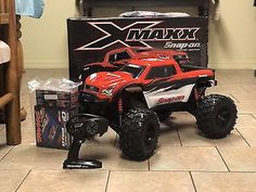Price - $1,500.00. Snap-On Traxxas X-Maxx RC Truck Limited Edition Red 1/5 Scale X Maxx 8S 50 MPH ( Motor Type - Brushless, Model Grade - Hobby Grade, 4WD/2WD - 4WD, Scale - 1:5, Color - Red, Type - Monster Truck, Model - X-Maxx, Fuel Type - Electric, Required Assembly - Ready to Go/RTR/RTF (All included), Brand - Traxxas    )