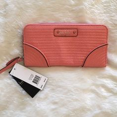 Nicole Miller Coral Wallet Gorgeous coral Nicole Miller wallet. Brand new with tags. Full zip around closure. Zipper change section, 16 slot credit card holder, ID slot, 2 sections for bills and check section. Retail 45. ❌ NO TRADES ❌ NO LOWBALLING ❌ Nicole Miller Bags Wallets