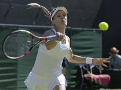 Eugenie Bouchard returns to Ying-Ying Duan during their singles match.  Pavel Golovkin, AP