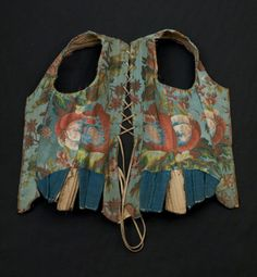 Corset bodice * 1735 - 1750 Made from blue silk brocade with a large scale design of naturalistic flowers in pinks, greens and yellows. This is French silk - point rentree 1735-1737. There are blue linen tabs. It is lined with linen. It is heavily boned with eyelet holes down the backs and fronts for the stomacher. Sleeves would attach with blue ribbon. The cuff of the sleeves is trimmed with cream silk ribbon. There are 6 hip tabs. (female) (foundation garment)