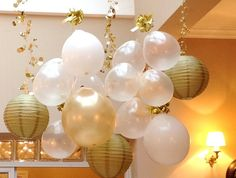 Balloons for Party Decor - I love the upside down hanging balloons with fun ribbon. Saves helium!