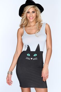 For all you kitty lovers this trendy little dress is for you! This adorable dress will captivate everyones attention towards you! Get the look the gets you noticed and add this slinky dress to your collection! Youll love it the moment you try it on! It features kitty print, scoop neck, sleeveless, and tight fitted. 95% Polyester 5% Spandex. Made in USA.
